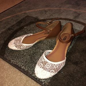 Brown and white ballet flats